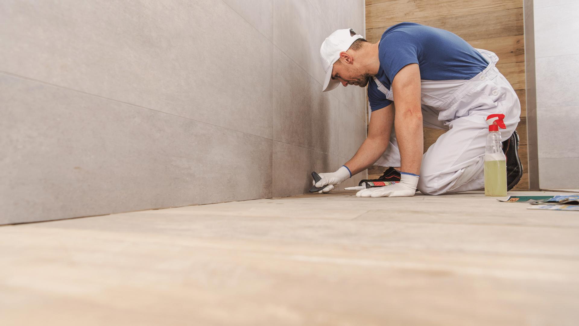 bathroom remodeling contractor installing tile
