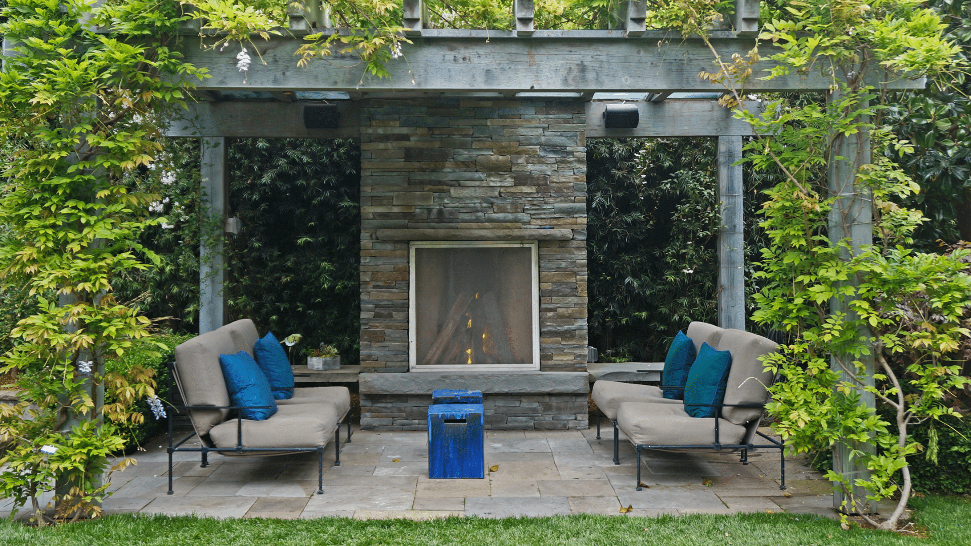 Pergola with fireplace and outdoor seating